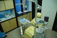 SmileMakeOver Dental & Aesthetic Center treatment room photo #1
