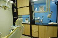 SmileMakeOver Dental & Aesthetic Center treatment room photo #7