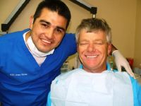 Castle Dental Dr. Beltran with his happy customer photo #1