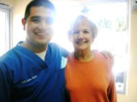 Castle Dental Dr. Beltran with his happy customer photo #3