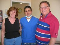 Castle Dental Dr. Beltran with his happy customers photo #4