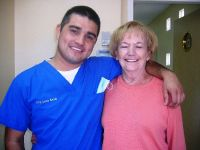 Castle Dental Dr. Beltran with his happy customer photo #6