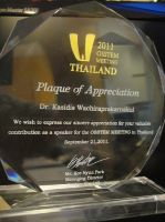 OrthoSmile Dental Clinic Dr. Kasidis OOSTEM Meeting Plaque of Appreciation for valuable contribution