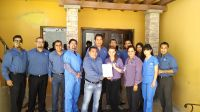 Sani Dental Staff with Global Patient Award Certificate