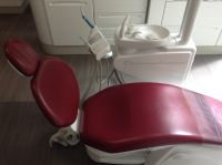 Dr. Mario Garita-The Dental Experience, Red Chair