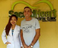 Sacred Heart Dental Clinic - The Doctor with a satisfied patient