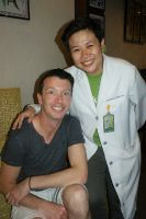 Sacred Heart Dental Clinic - One of their Dentists with a satisfied patient.