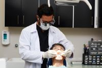 Dental Cosmetics- Dentists in a Procedure