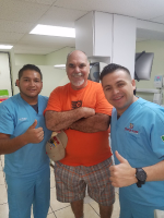 Supreme Dental Clinic, Happy patient with staff
