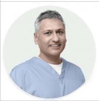 Dr.  ADRIAN SINANNAN