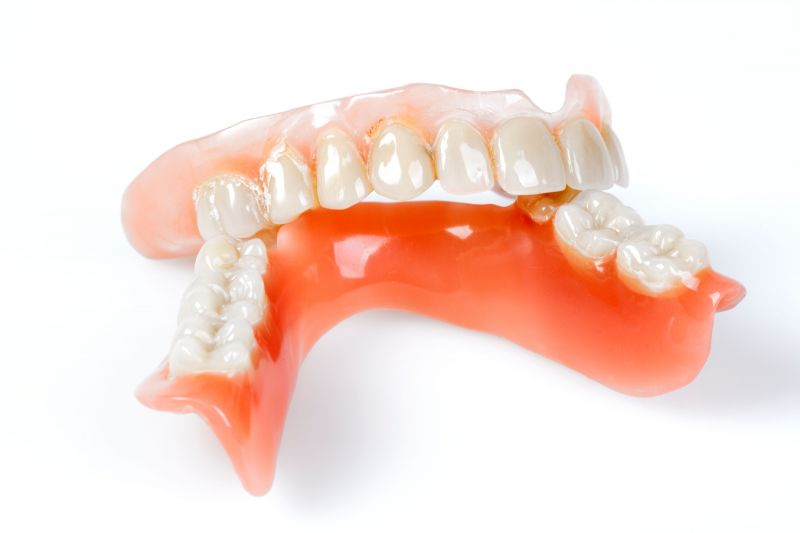 Bar supported denture